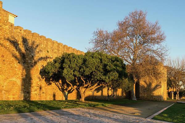 Photograph - Lagos Algarve Portugal - Long Shadows On The Rough Crenelated Walls by Georgia Mizuleva