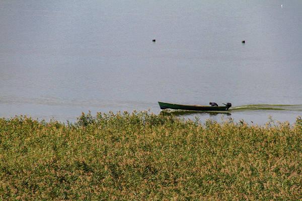 Wall Art - Photograph - Lake Tranquillity Broken By A Passing Boat by Iordanis Pallikaras