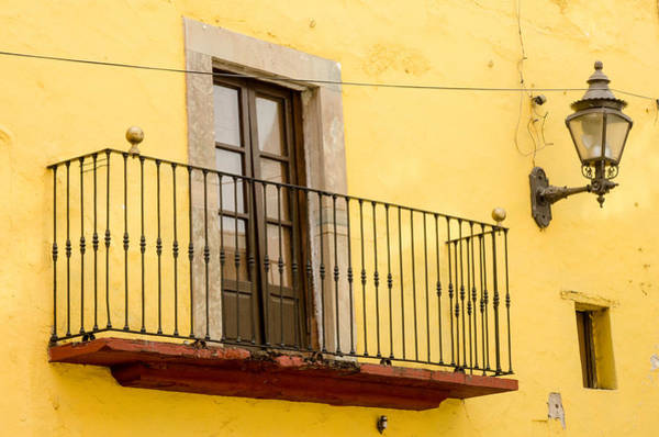 Photograph - Lamp And Balcony On Yellow Stucco Wall by Rob Huntley