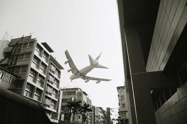 Photograph - Landing In Hong Kong by Shaun Higson