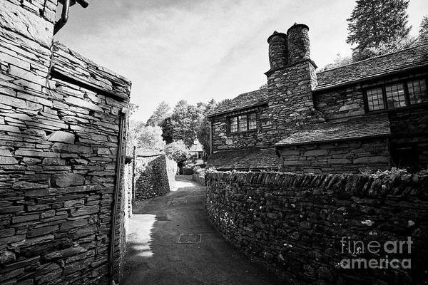 Grasmere Wall Art - Photograph - Lane Through Traditional Lake Stone Slate Built Cottages In The Hamlet Of Town End Near Grasmere Lak by Joe Fox