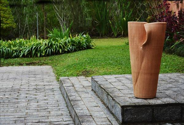Photograph - Large Ceramic Vase Isolated In Garden by Airo Zamoner