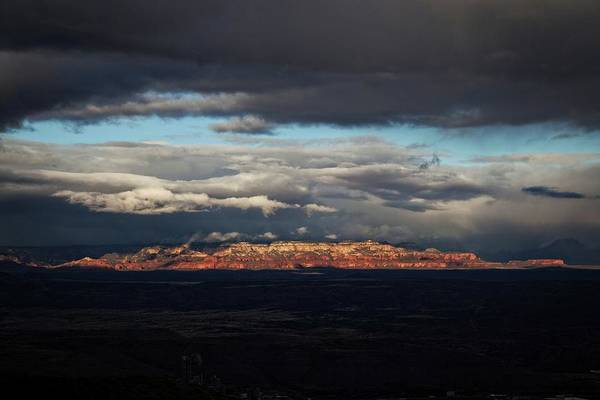 Photograph - Late Light On Red Rocks With Storm Clouds by Ron Chilston