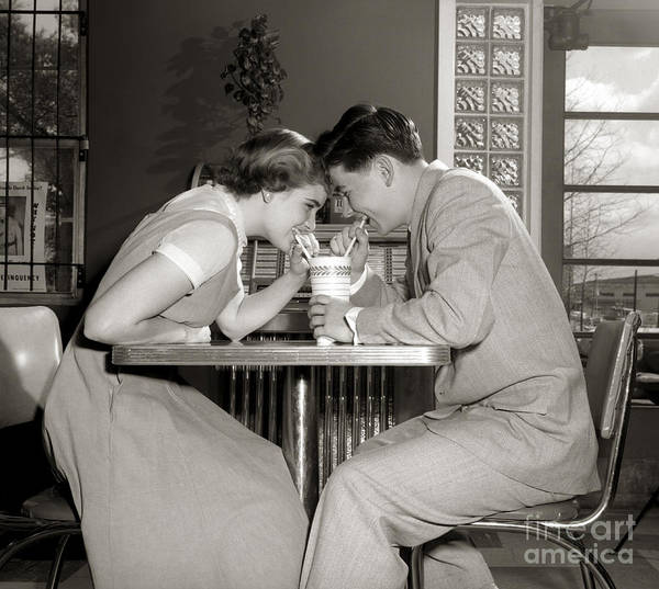 Photograph - Laughing Couple Sharing A Drink by H. Armstrong Roberts/ClassicStock