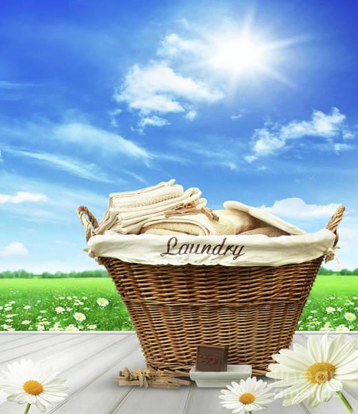 Photograph - Laundry Basket With Clothes On Rustic Table Against Blue Sky by Sandra Cunningham