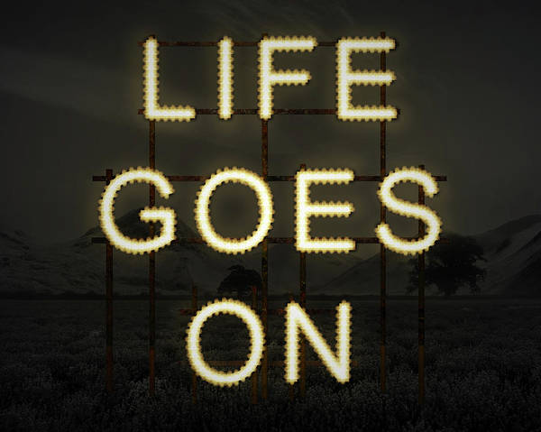 Lavender Mist Wall Art - Photograph - Life Goes On Inspiring Text In Lights Against Dark Landscape Bac by Matthew Gibson