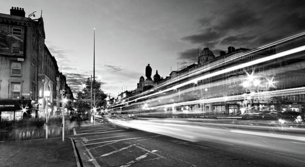 Photograph - Light Trails On O'connell Street At Night - Dublin by Barry O Carroll