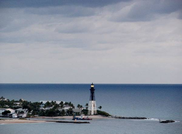 Photograph - Lighthouse And Rain Clouds by Corinne Carroll