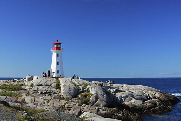 Photograph - Lighthouse At Peggy's Cove by Tatiana Travelways