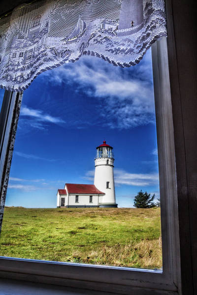 Photograph - Lighthouse Through The Window by Debra and Dave Vanderlaan