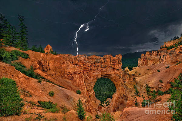 Photograph - Lightning Over Natural Bridge Formation Bryce Canyon National Park Utah by Dave Welling