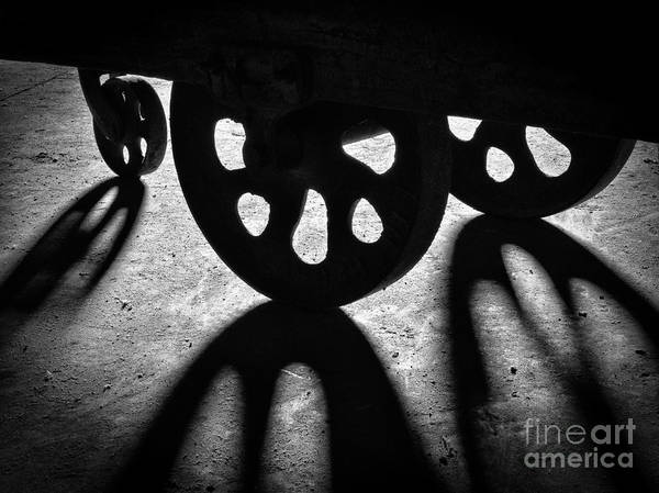 Photograph - Lineberry Factory Cart Wheels Bw by Patrick M Lynch