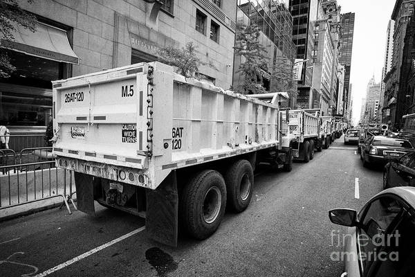 Dump Truck Photograph - Line Of Construction Trucks Filled With Sand As Defences Outside Trump Tower On Fifth Avenue Midtown by Joe Fox