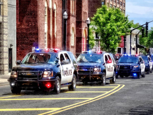 Photograph - Line Of Police Cars by Susan Savad