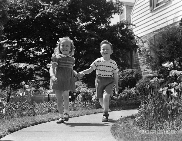 Photograph - Little Boy And Girl Walking, Holding by H. Armstrong Roberts/ClassicStock