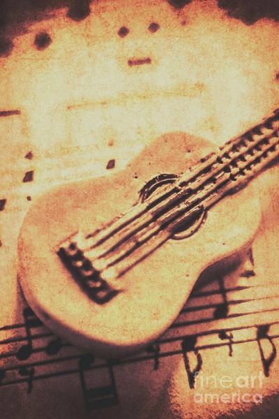 Carve Photograph - Little Carved Guitar On Sheet Music by Jorgo Photography - Wall Art Gallery