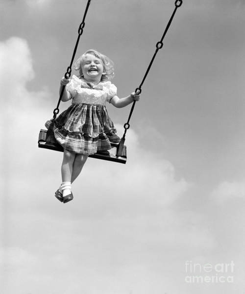 Exuberance Photograph - Little Girl Swinging And Laughing by Pound/ClassicStock
