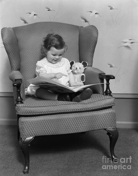 Wall Art - Photograph - Little Girl With Picture Book, C.1930s by H. Armstrong Roberts/ClassicStock