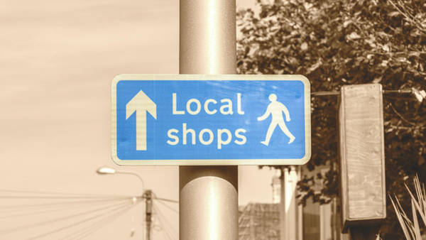 Photograph - Local Shops English Blue Street Sign Isolated On Sepia by Jacek Wojnarowski