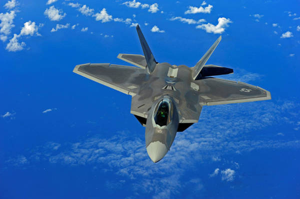 Laser Gun Photograph - Lockheed Martin F-22 Raptor Above The Sea by L Brown