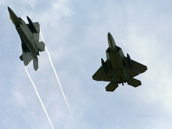 Wall Art - Photograph - Lockheed Martin F-22 Raptors Confronting Enemy Fighters by L Brown