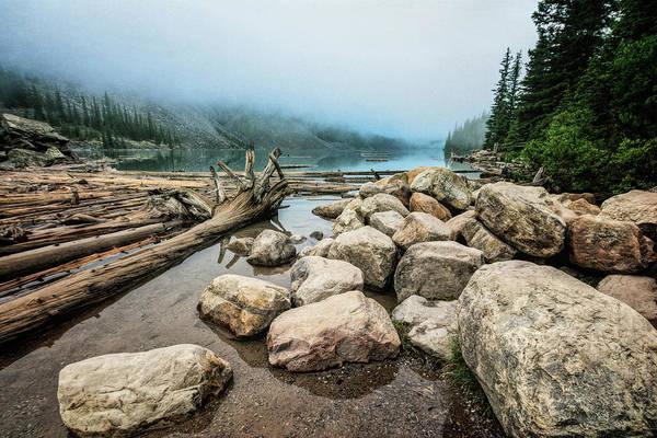 Moraine Lake Photograph - Logs And Boulders Moraine Lake Banff by Joan Carroll