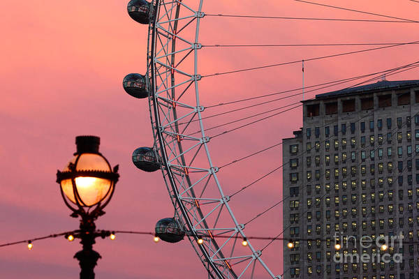 Photograph - London Eye And Shell Centre Building At Sunset by James Brunker