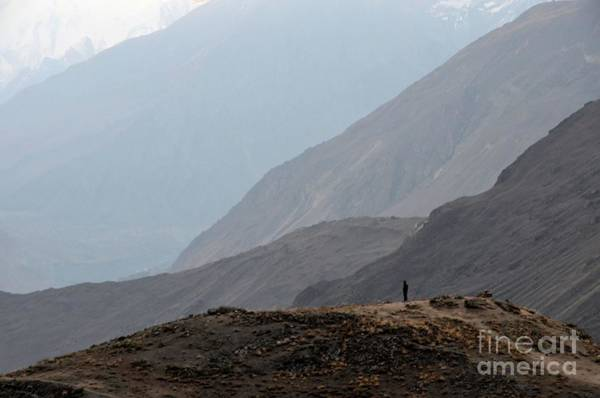 Photograph - Lone Individual Watches Sunrise Among Mountain Peaks In Hunza Valley Pakistan by Imran Ahmed
