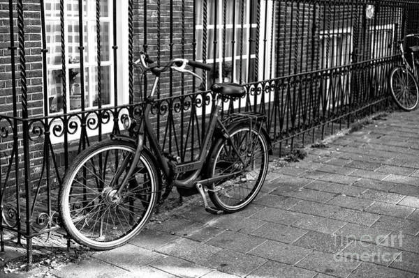 Photograph - Lonely Bicycle In Amsterdam Mono by John Rizzuto