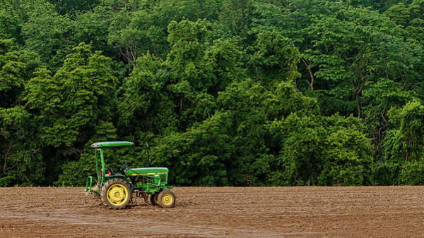 Photograph - Lonely Tractor In Open Field by Gary Slawsky