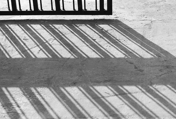 Wall Art - Photograph - Long Shadow Of Metal Gate by Prakash Ghai