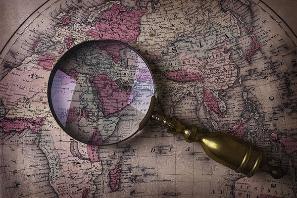 Wall Art - Photograph - Magnifying  Glass On Old Map by Garry Gay