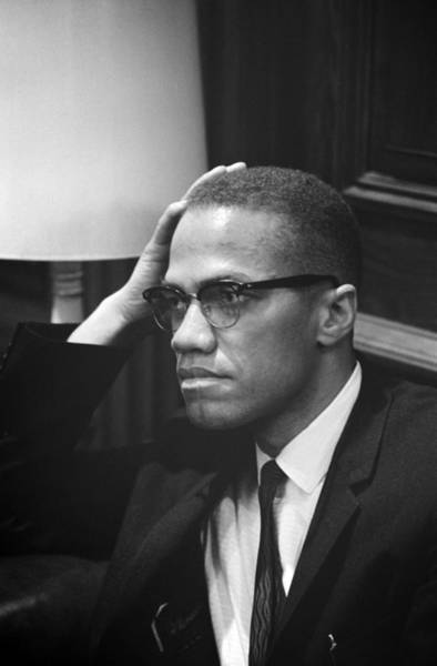 Candid Photograph - Malcolm X, Malcolm X Waits At Martin by Everett