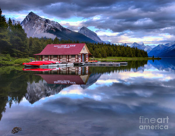Photograph - Maligne Lake Boathouse Spring Clouds by Adam Jewell