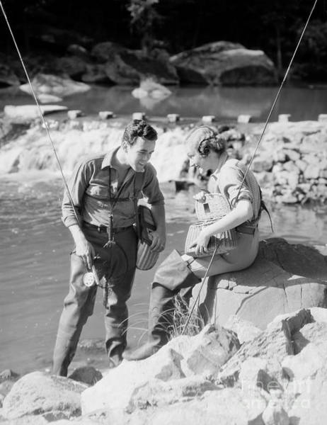Photograph - Man And Woman Fly Fishing by H. Armstrong Roberts/ClassicStock