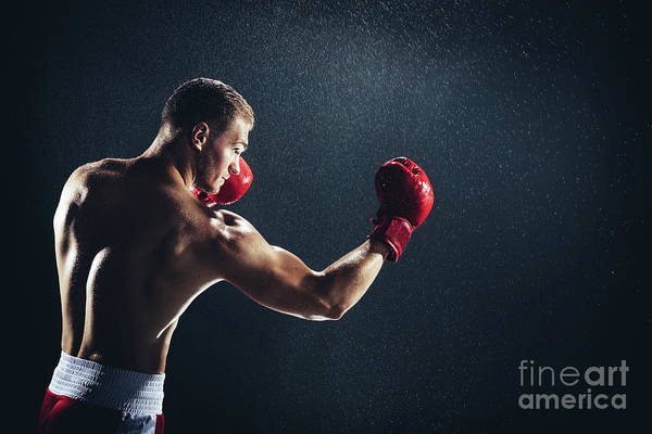 Kickboxing Photograph - Man Boxing With Red Gloves On His Hands In The Rain. by Michal Bednarek