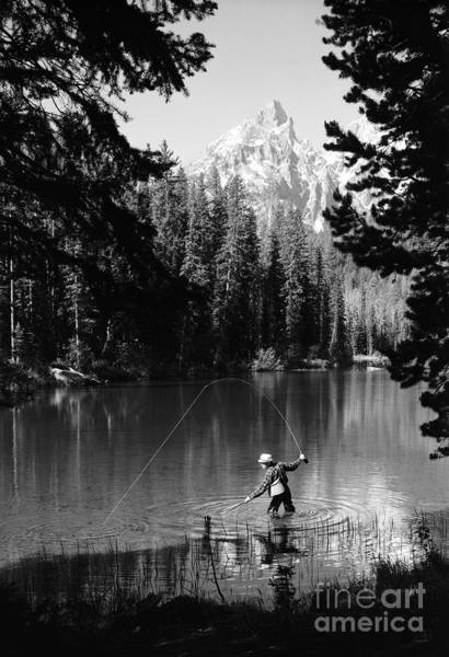 Photograph - Man Fishing With Net And Rod by D. Corson/ClassicStock
