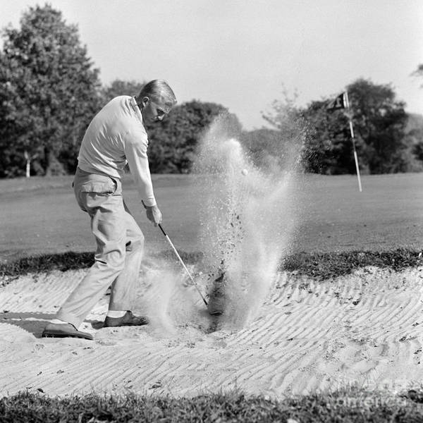 Photograph - Man Golfing In Sand Trap, C.1960s by H. Armstrong Roberts/ClassicStock