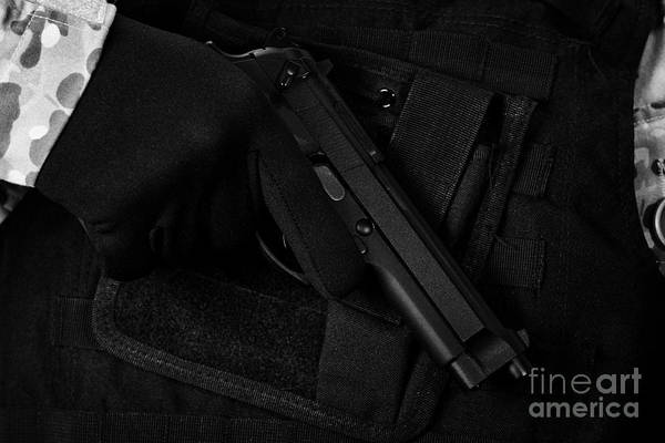 Beretta Photograph - Man In Combat Fatigues And Bullet Proof Jacket  Holding Beretta Semi Automatic Pistol by Joe Fox