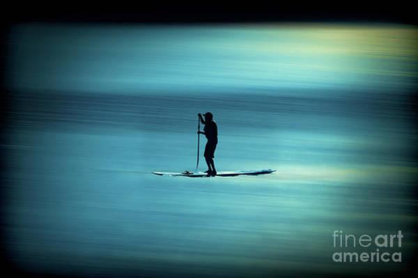 Photograph - Man Paddling Board On Lake Sun Setting by Dan Friend