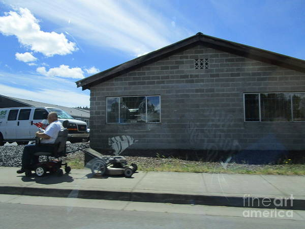 Photograph - Man Wheelchair Lawnmower by Marie Neder