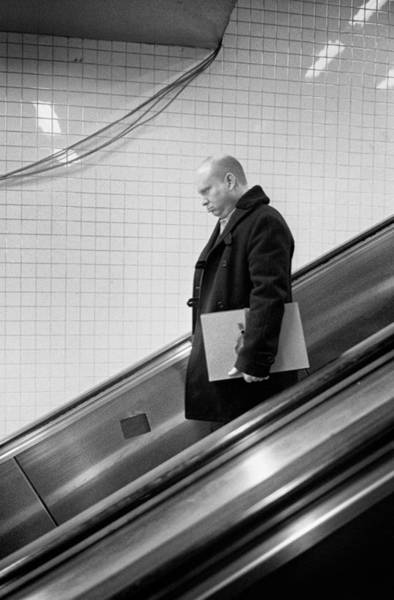 Photograph - Man With Envelope On Escalator by Dave Beckerman
