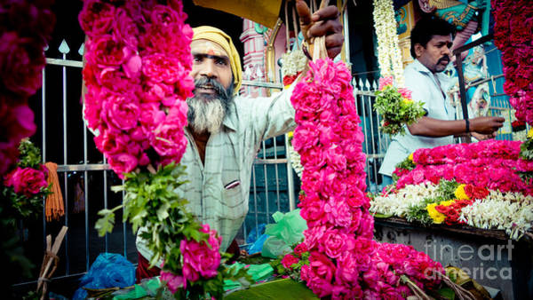 Photograph - Man With Flowers Near The Temple Kerala Yatra 2016 Yantra by Raimond Klavins