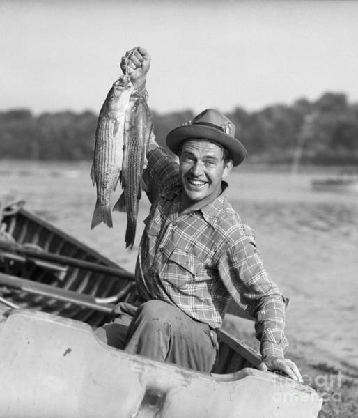 Photograph - Man With Fresh Caught Fish by Debrocke/ClassicStock