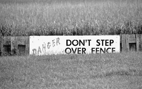 Photograph - Marsh Danger Sign by Cynthia Guinn