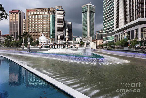 Photograph - Masjid Jamek And Bank Towers By The Klang River In The Heart Of  by Didier Marti