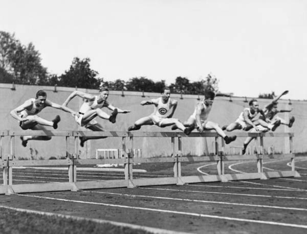 Photograph - Men Running High Hurdles by Underwood Archives