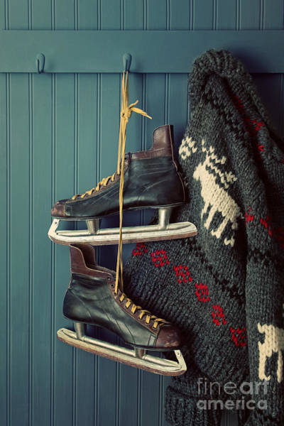Photograph - Men's Vintage Skates  And Sweater Hanging On Hooks by Sandra Cunningham
