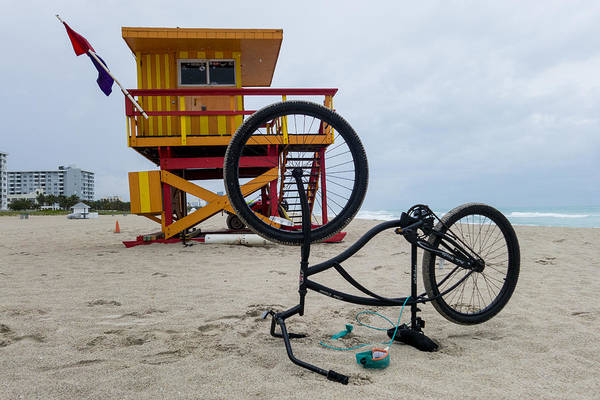 Photograph - Miami Beach Life Guard House Upside Down Bicycle by Toby McGuire