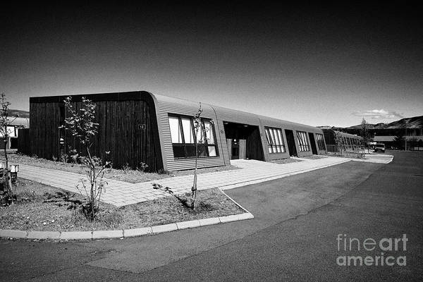 Wall Art - Photograph - modern geothermally heated bungalow homes in hveragerdi Iceland by Joe Fox